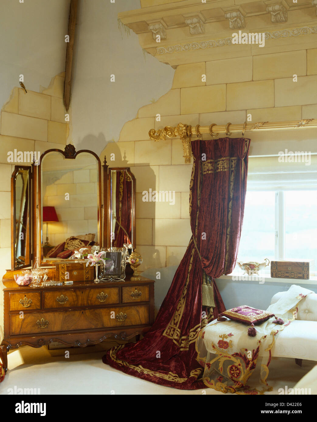 Antique dressing table with mirror - Antique Dressing Table With Triple Mirror In Bedroom With Red Curtain And Trompe L Oeil Stone Wall Paint Effect On The Walls