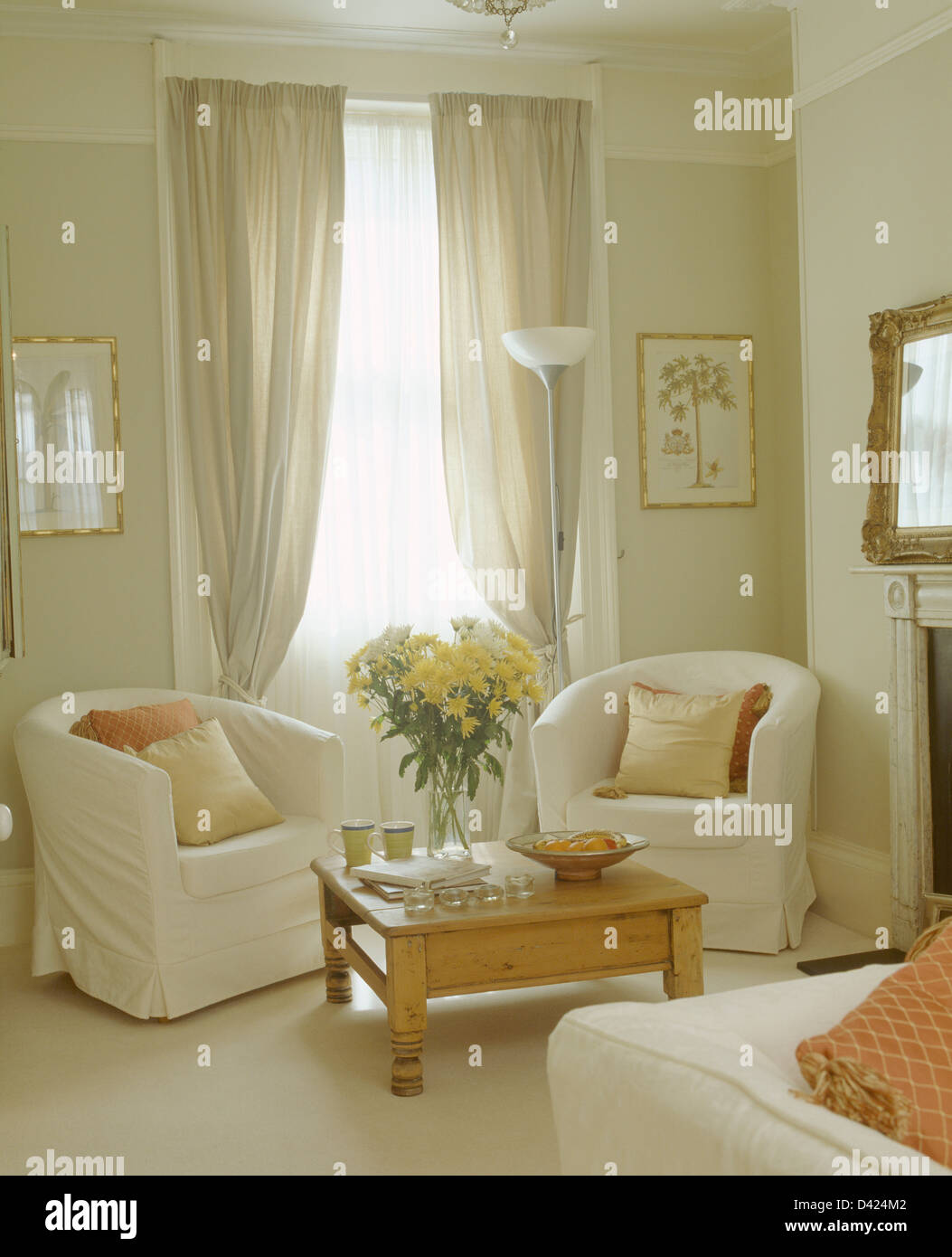 Stock Photo   White Loose Covers On Tub Chairs In Front Of Window With Pale  Gray And White Cotton Curtains In Townhouse Living Room Part 34