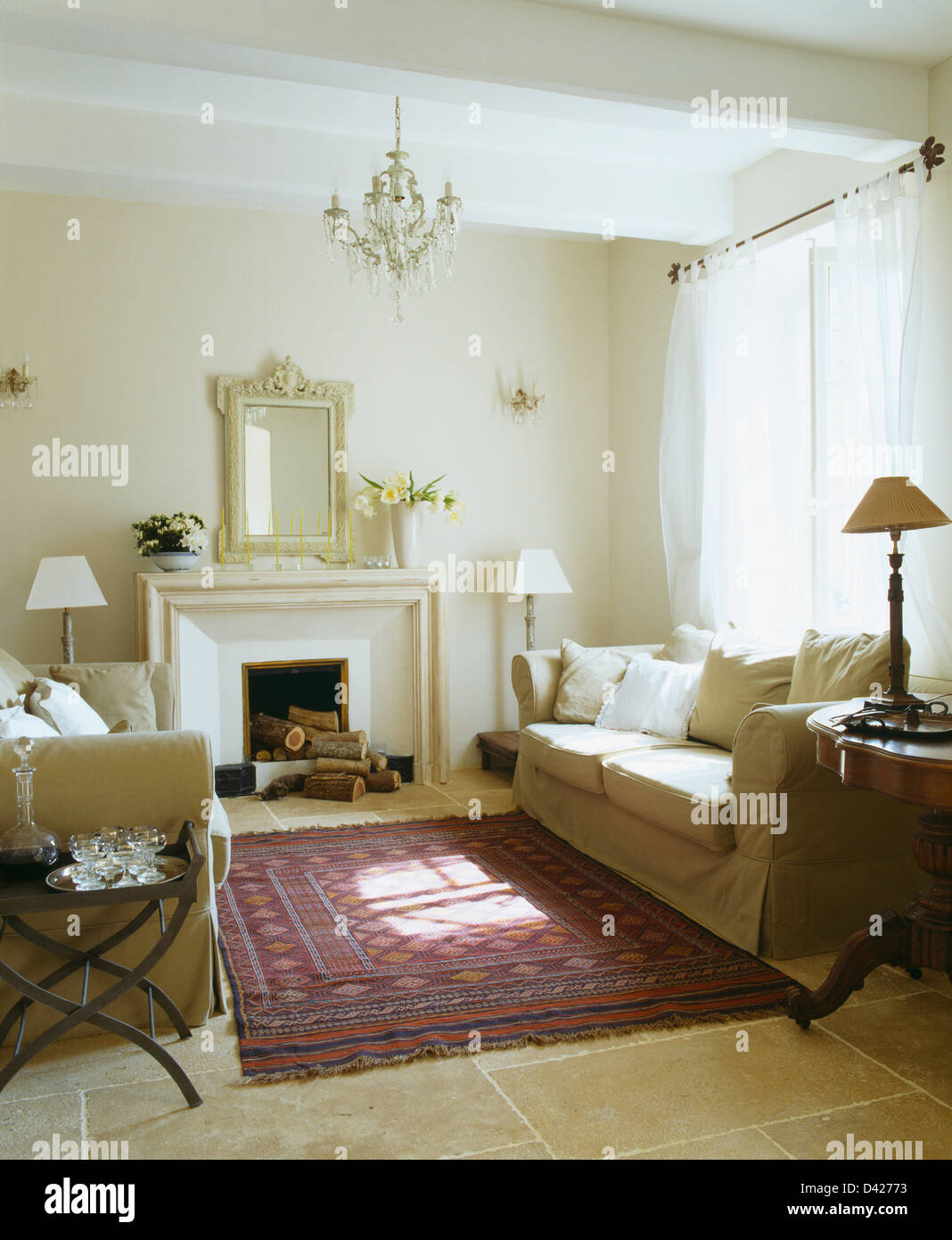 Cream Sofas And Voile Curtains In White French Living Room With Oriental  Rug On Stone Flooring