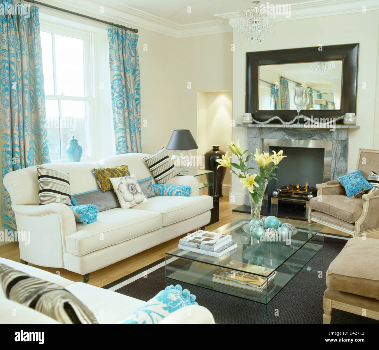 Attractive Patterned Turquoise Curtains On Window Above White Sofa In White Living Room  With Large Mirror Above Fireplace