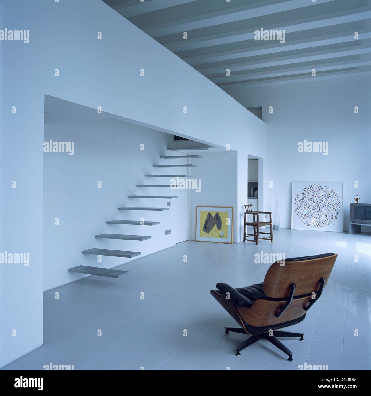 Charles Eames Lounge Chair In Loft Conversion With Floating Staircase And  White Beamed Ceiling