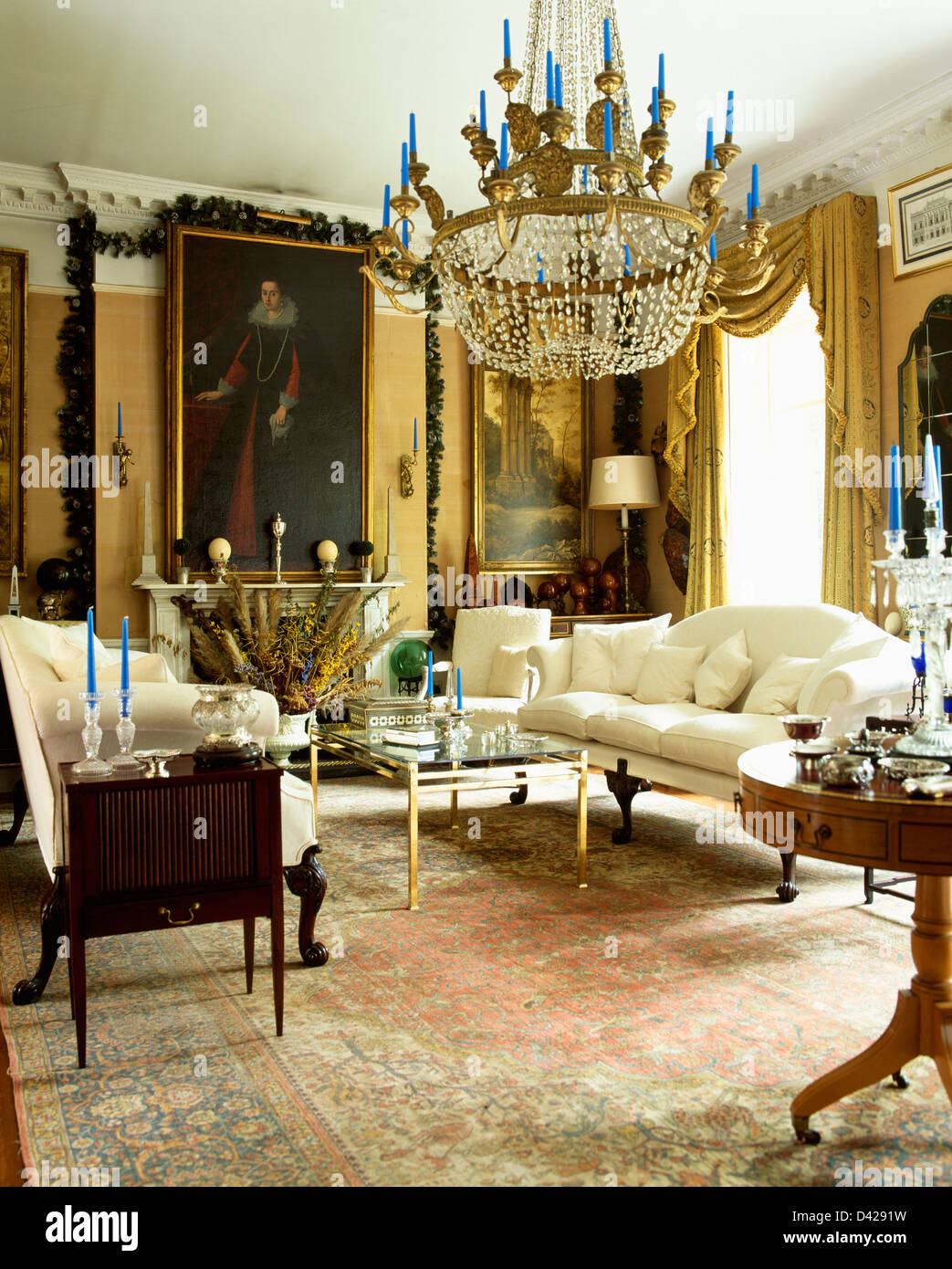 Large antique crystal chandelier and tall oil portraits in drawing large antique crystal chandelier and tall oil portraits in drawing room with silk carpet and white sofas arubaitofo Choice Image