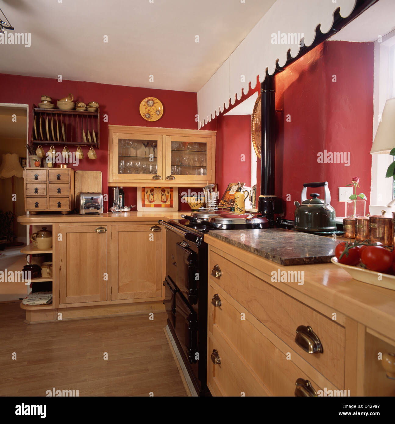 Black aga and pale wood fitted units in red country for Red fitted kitchen