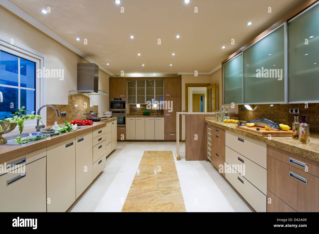 large modern kitchen in spanish villa with recessed ceiling lights and marble insert in white ceramic floor - Modern Kitchen Ceiling Lights