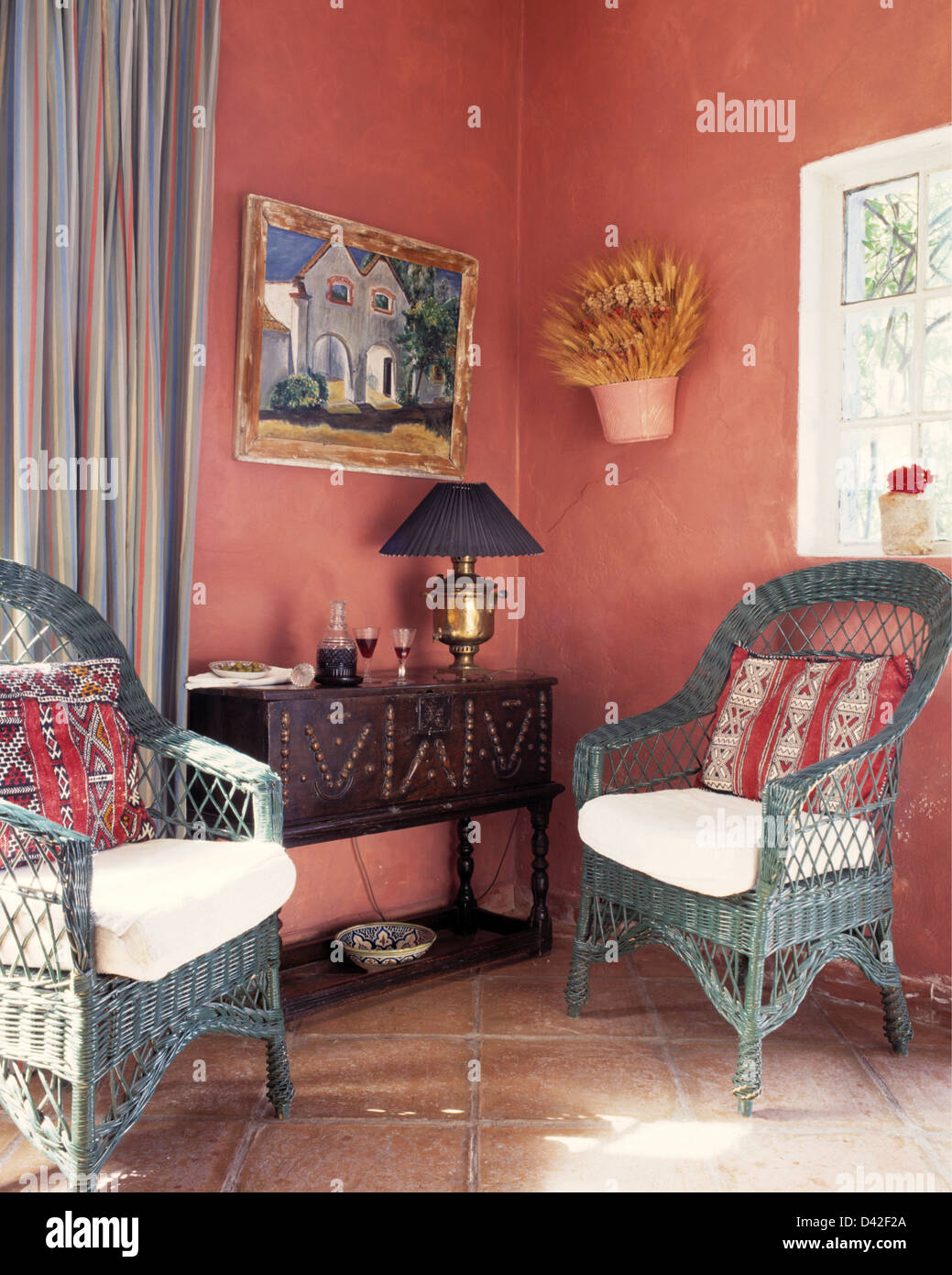 Cane chairs with cushions - Grey Blue Cane Chairs With Colorful Cushions In Pink Spanish Country Living Room With Carved Wood Console Table
