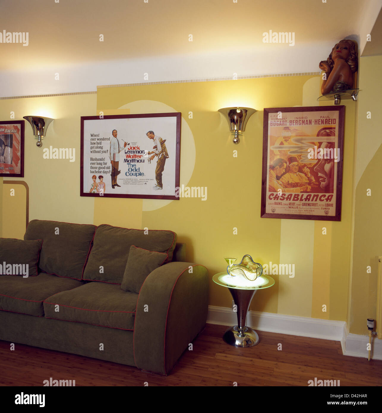 Brown sofa and small chrome table in retro living room with ...