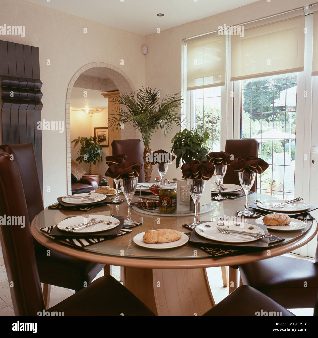 modern circular table set for lunch in traditional dining room modern circular table set for lunch in traditional dining room with white blinds on the window
