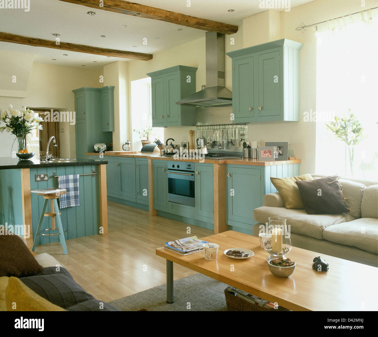 Pale Blue Fitted Units In Country Kitchen With Pale Wood