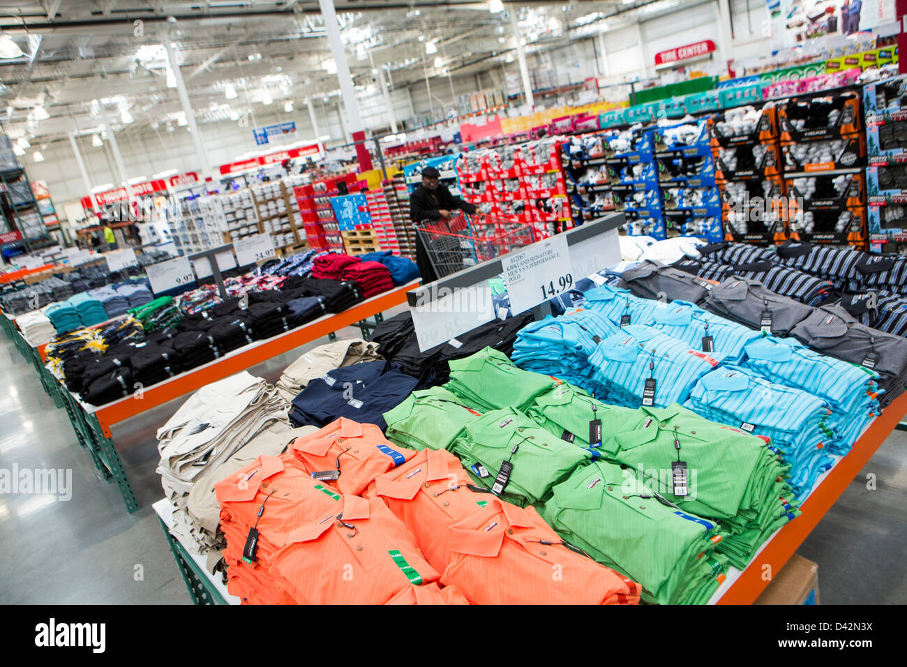 Customers shopping in the clothing section of a Costco ...