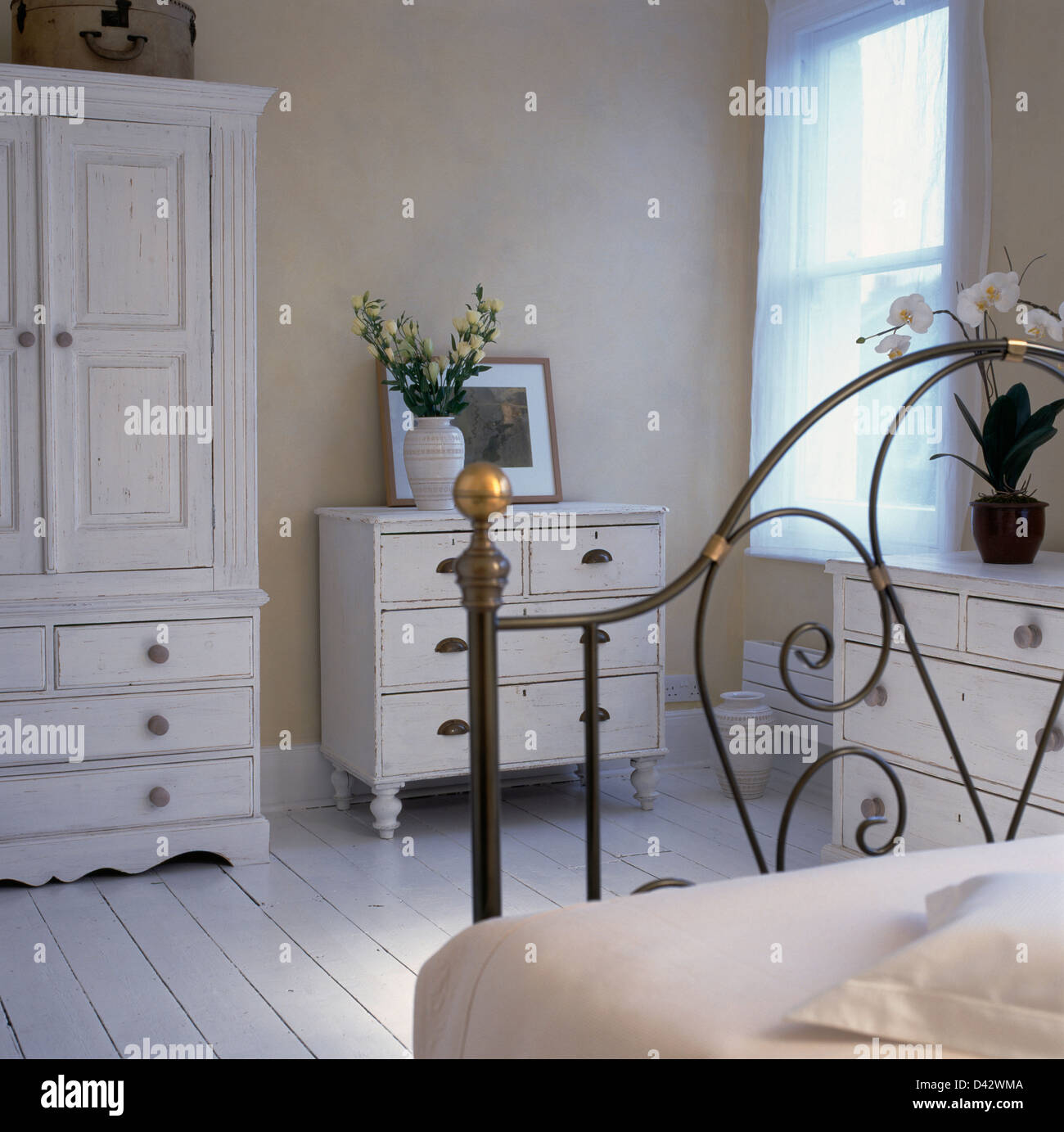 Pale Bedroom White Painted Wardrobe And Chest Of Drawers In Pale Beige Bedroom