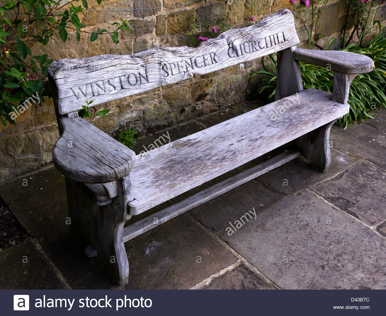 Old wooden carved oak bench seat outside winston churchill