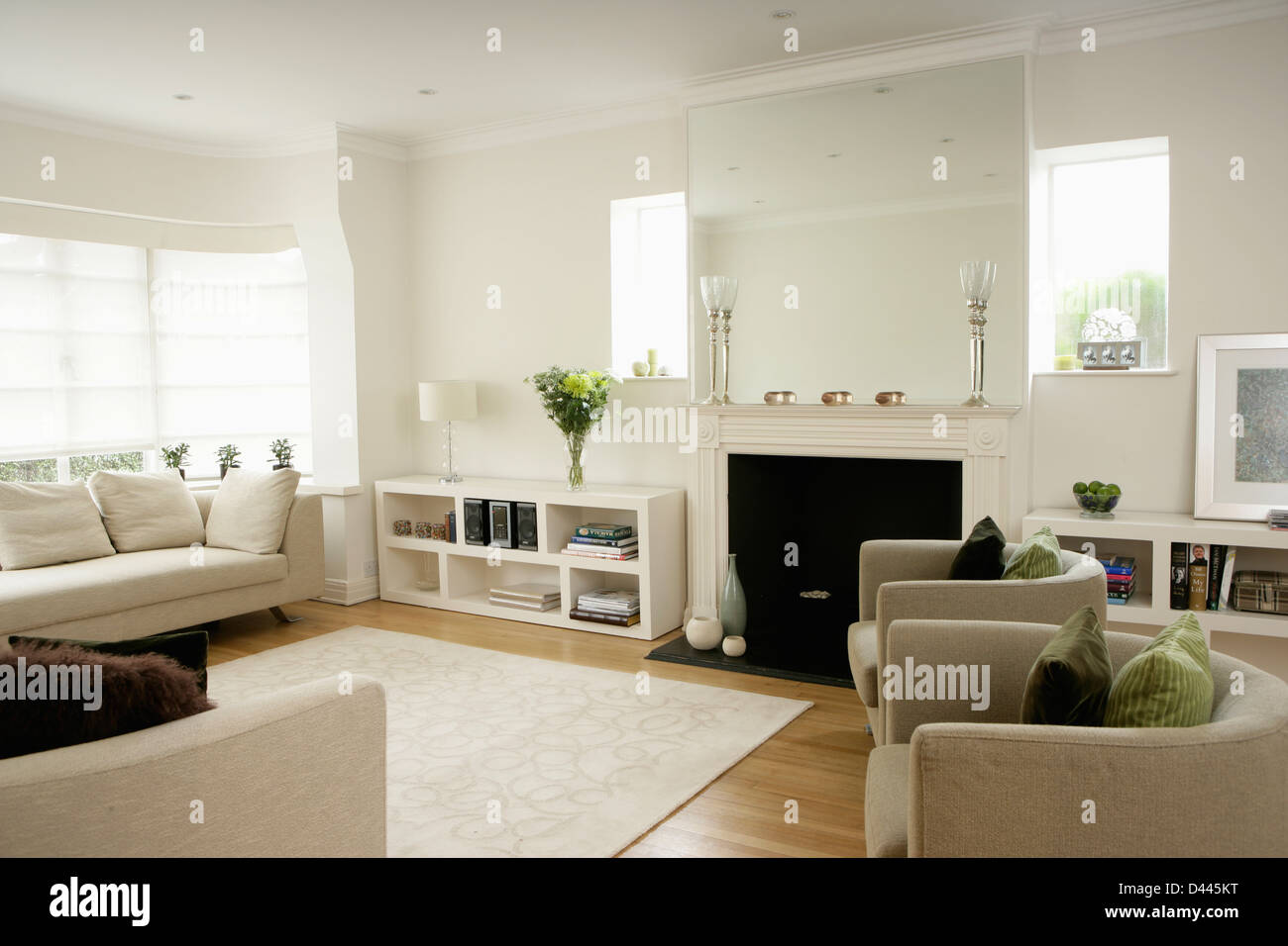 Low white shelf unit beside fireplace in modern white for Modern living room shelving units