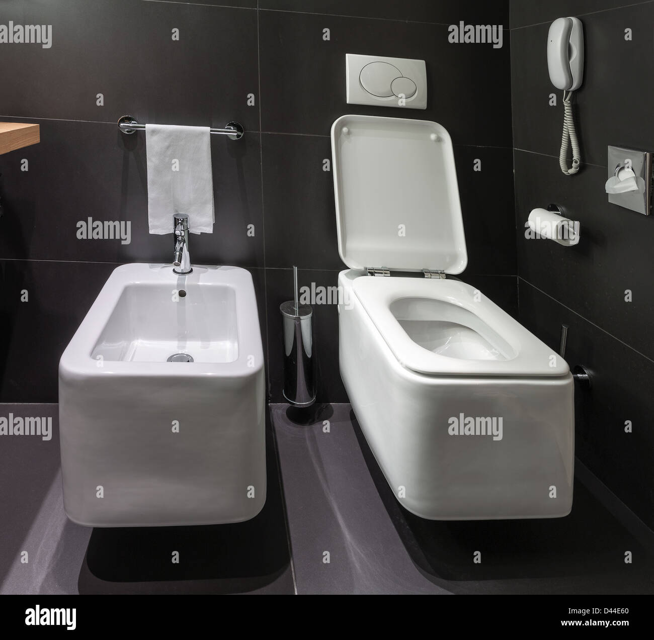 bathroom black toilet bowl bidet stock photos  bathroom black  - details of modern square toilet wc and bidet in black tiled bathroom stock image