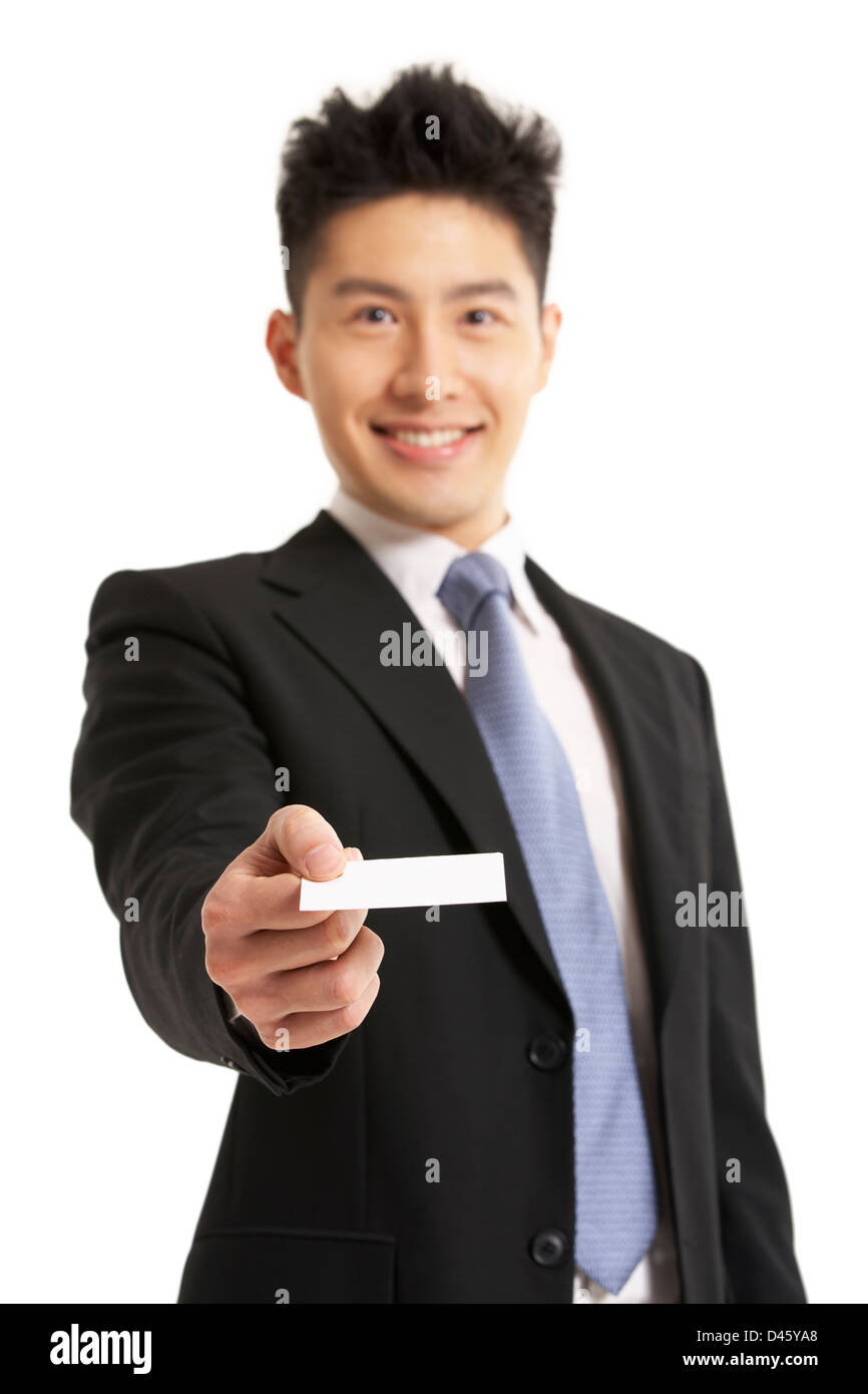 Studio Portrait Of Chinese Businessman Offering Business Card ...