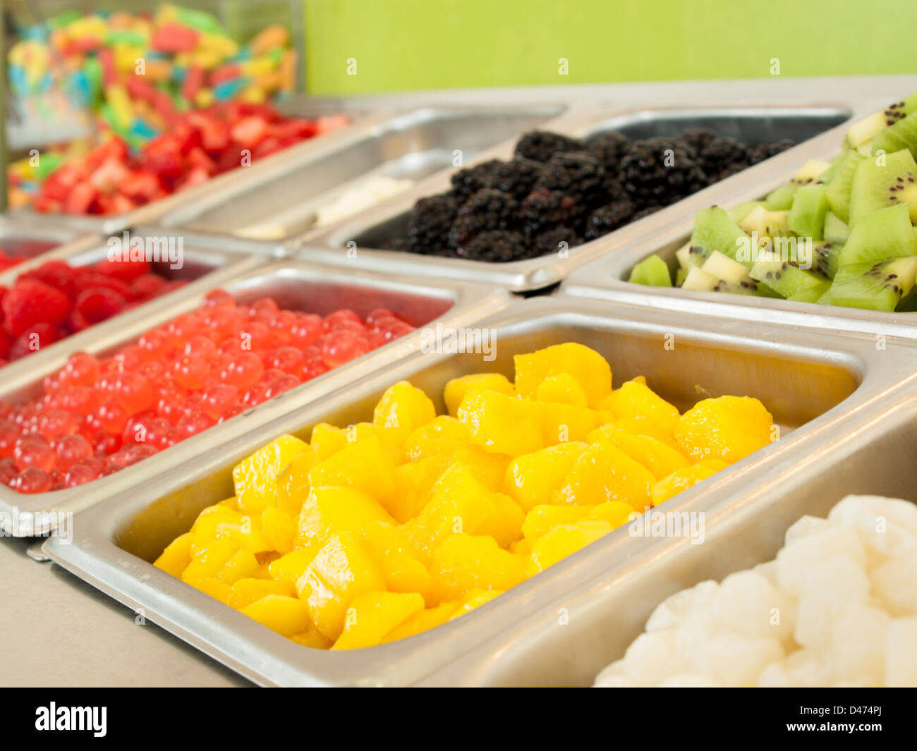 Bon  Frozen Yogurt Toppings Bar. Yogurt Toppings Ranging From Fresh Fruits,  Nuts, Fresh Cut Candies, Syrups And Sprinkles