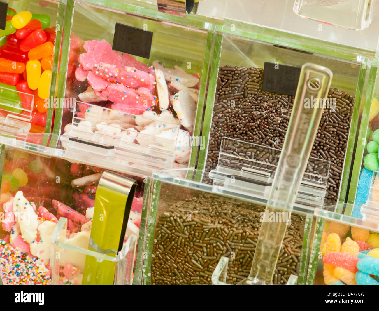 Frozen Yogurt Toppings Bar. Yogurt Toppings Ranging From Fresh Fruits,  Nuts, Fresh Cut Candies, Syrups And Sprinkles
