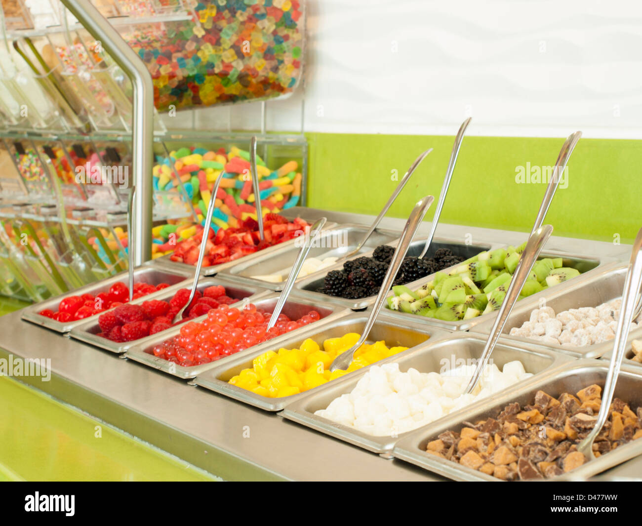 Superbe  Frozen Yogurt Toppings Bar. Yogurt Toppings Ranging From Fresh Fruits,  Nuts, Fresh Cut Candies, Syrups And Sprinkles