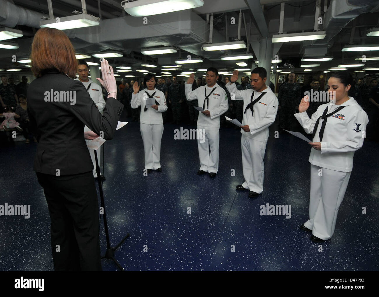 a united states department of homeland security immigration a united states department of homeland security immigration services officer issues the oath of citizenship to sailors