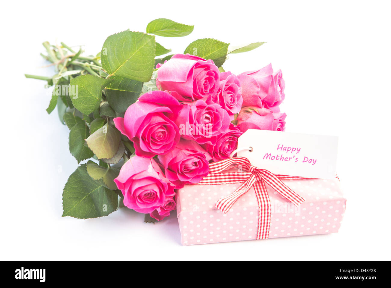Bouquet of pink roses next to a gift with a happy birthday card – Birthday Greetings with Roses