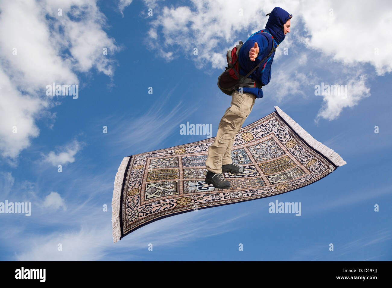 Man On A Magic Carpet Flying Up Across Blue Sky With White