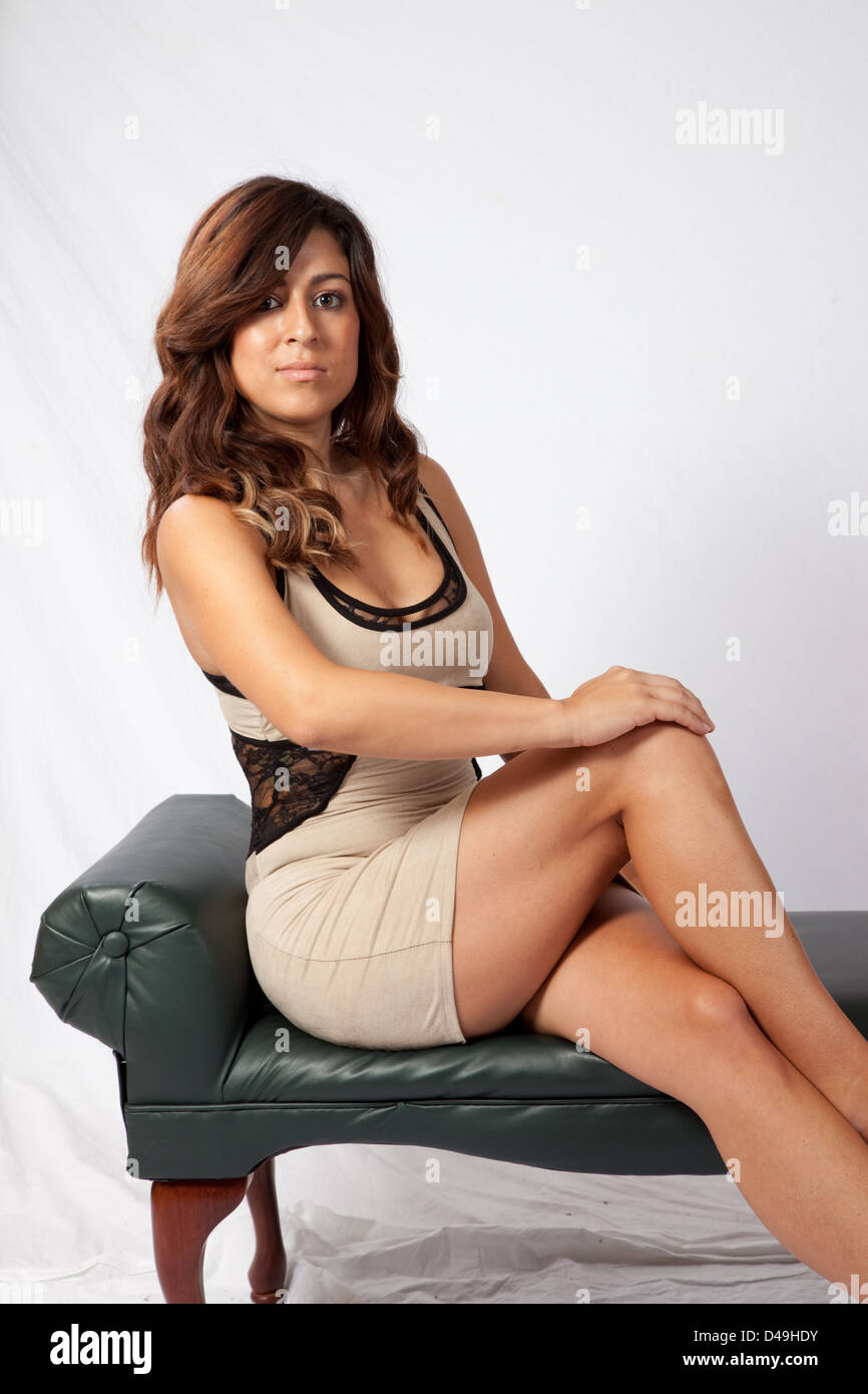 Pretty Woman Sitting Legs Crossed And Looking At The