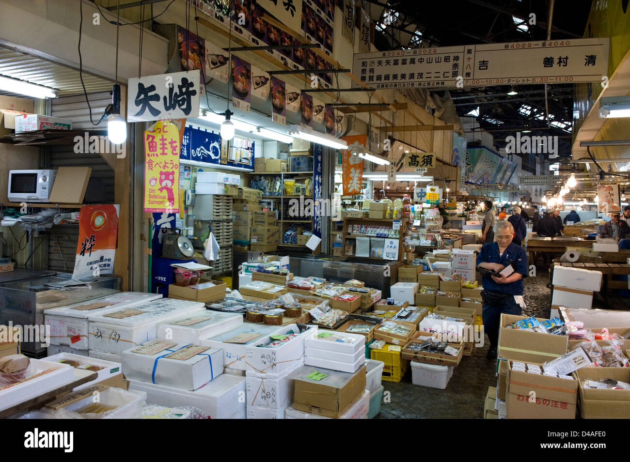Narrow aisles between crowded retail sales stalls at for Wholesale fish market