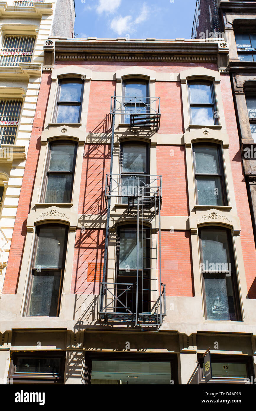 Apartment Building Fire Escape Ladder fire escape ladders on the building in manhattan stock photo