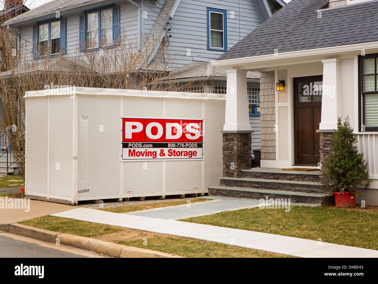 ARLINGTON, VIRGINIA, USA   PODS Storage Container In Front Of Houses.