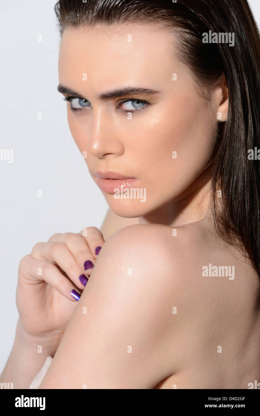 Stock Photo Close Up Woman Face Beauty Make Up, Looking Over Shoulder
