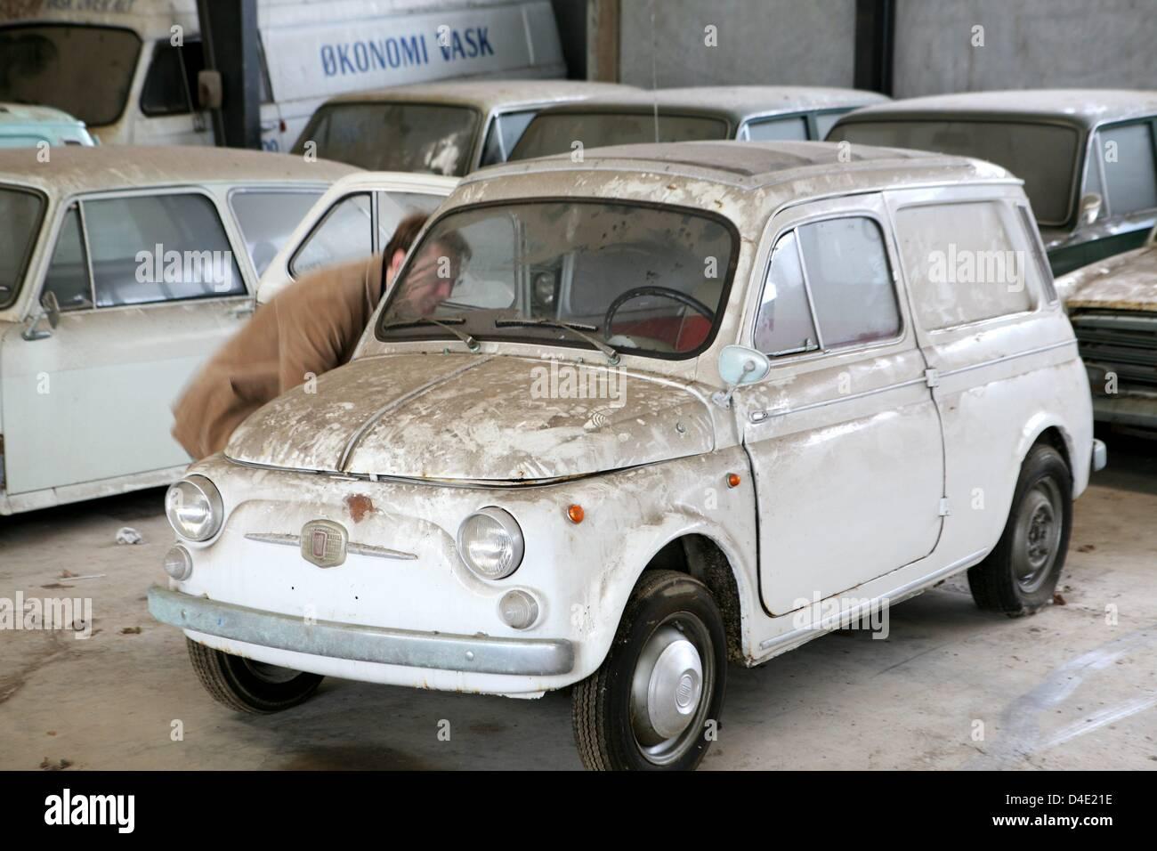 Car dealer Kjeld Soerensen sells old cars of the type Fiat in Stock ...