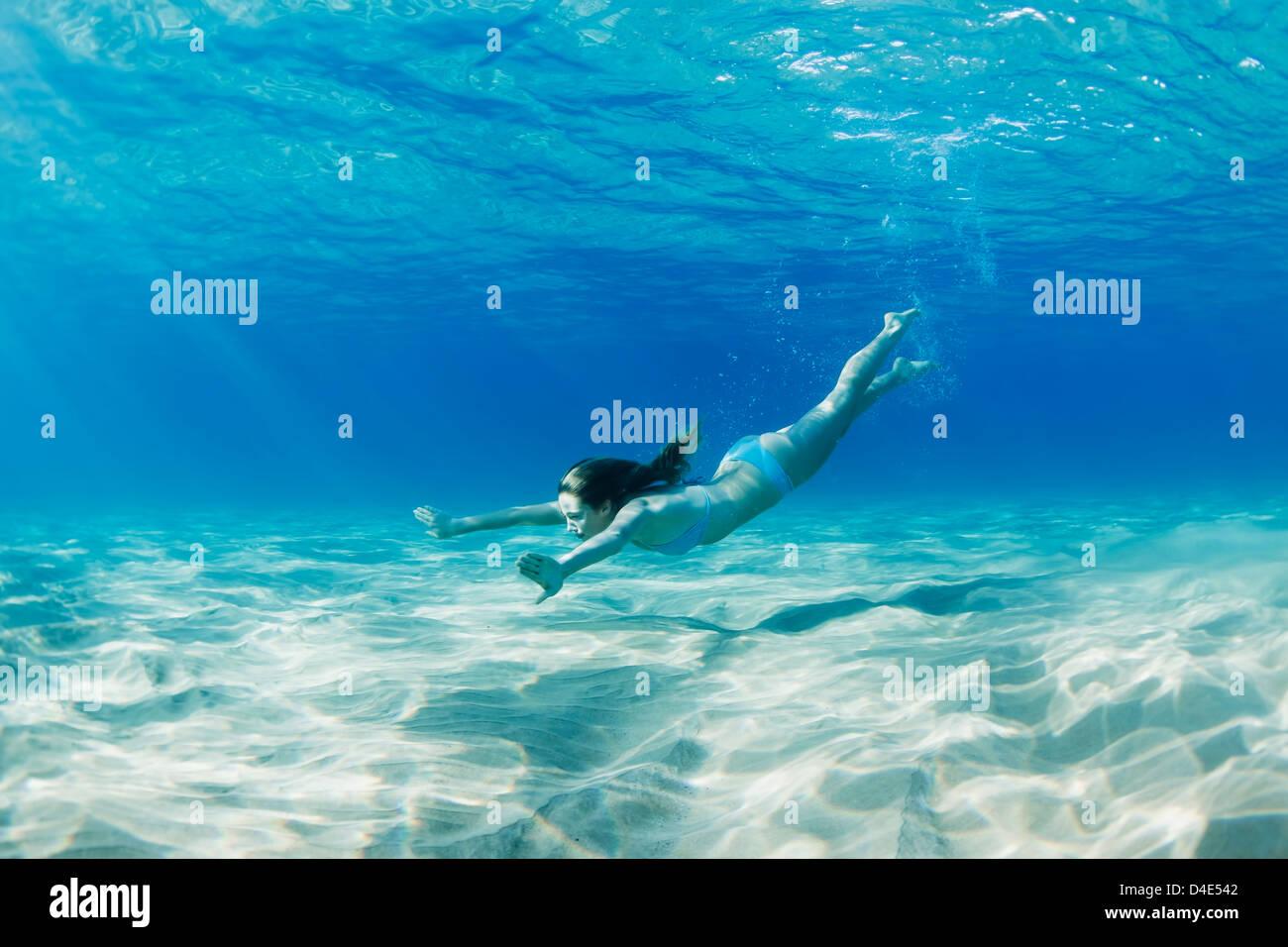 Amazing Hawaii, Maui, Makena, Young Woman Swimming Along The Ocean Floor.