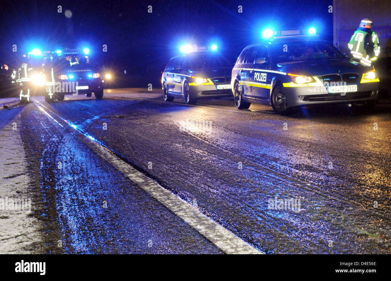 Police cars sit on ice-covered lanes on Autobahn A5 near Stock ...