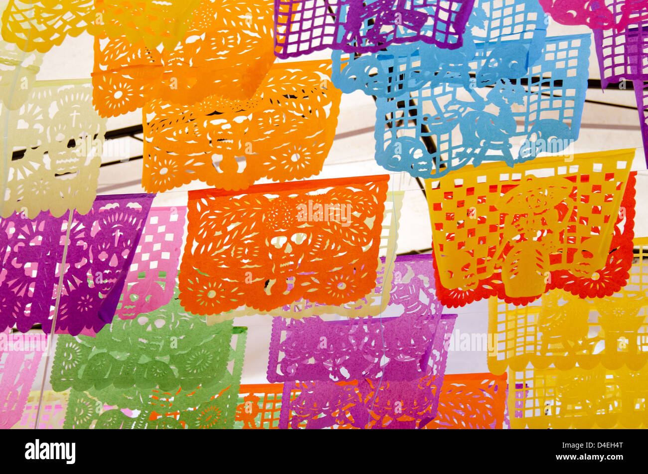 Brightly Colored Cut Paper Flags With Day Of The Dead Designs In Oaxaca Mexico