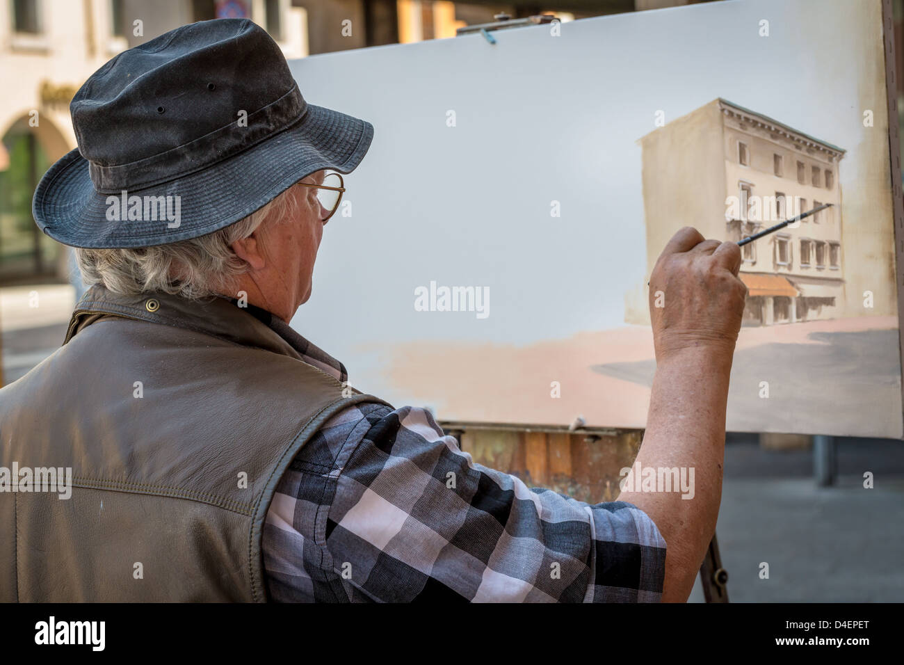 Painter Painting An Oil Painting Of A Old House In Udine, Italy ...