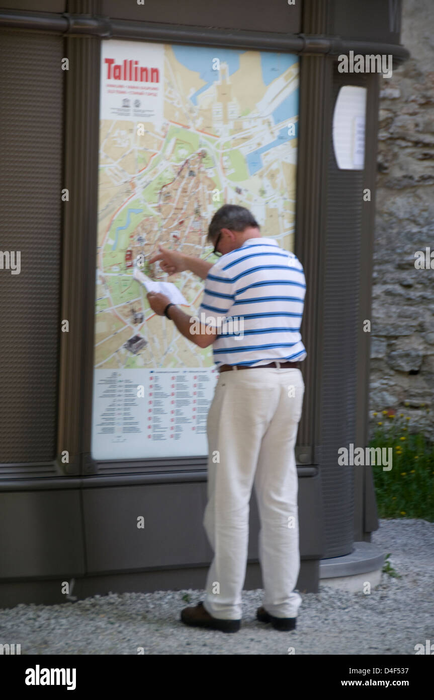 A tourist studying a large street map of Toompea a neighbourhood of