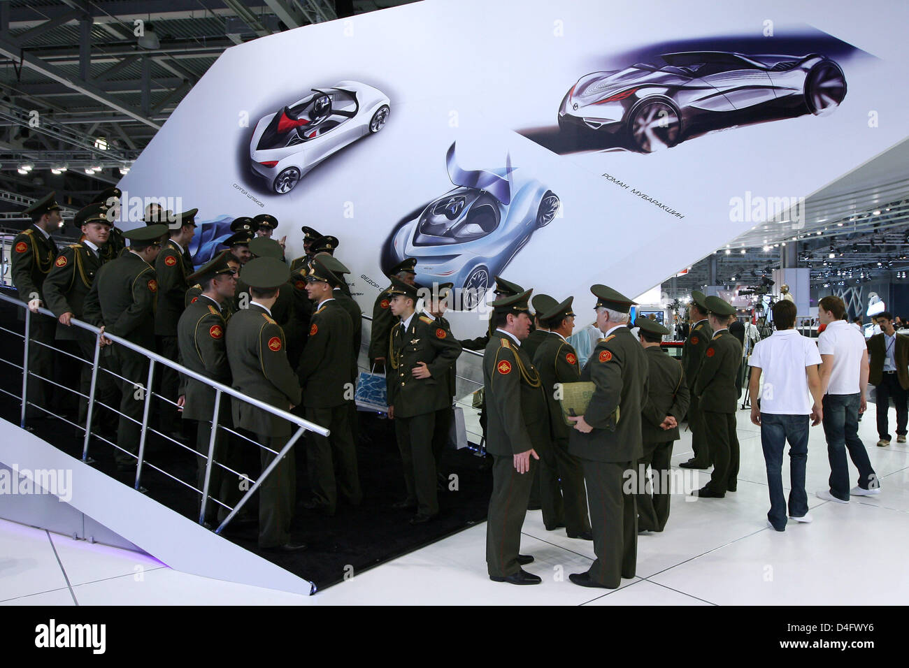Members Of A Russian Military Choir Visit The Mazda Stand At The - Mazda military