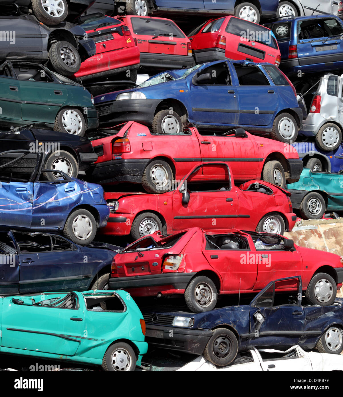 Scrapped cars piled up at a car recycling plant near Leverkusen ...