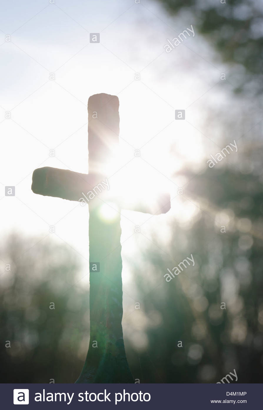Silhouette of the holy cross on background of storm clouds stock - Sun Shining Over Cross Outdoors Stock Image