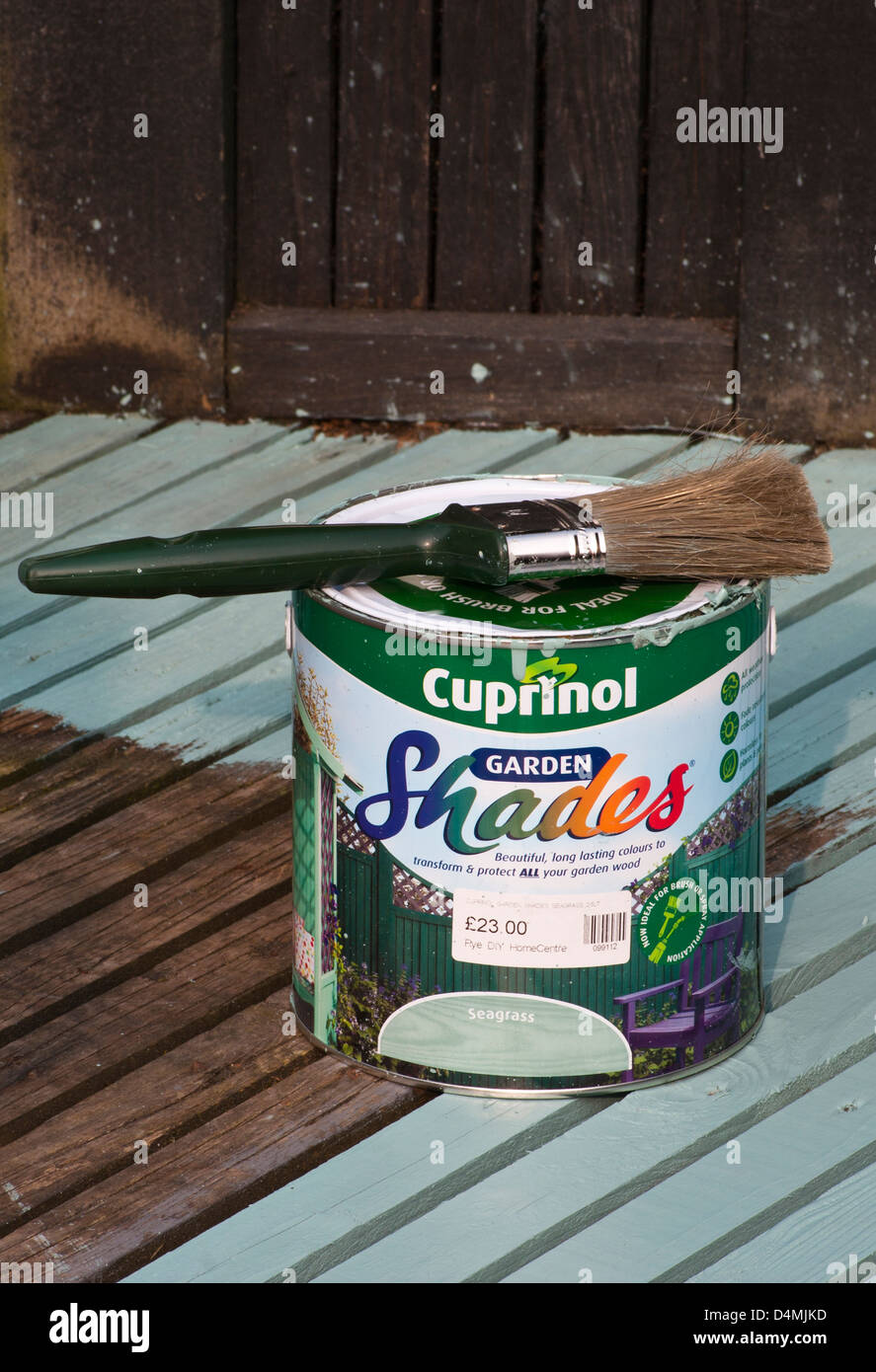 Paint Brush And A Tin Of Cuprinol Garden Wood Paint On Wooden Decking Stock Photo Royalty Free