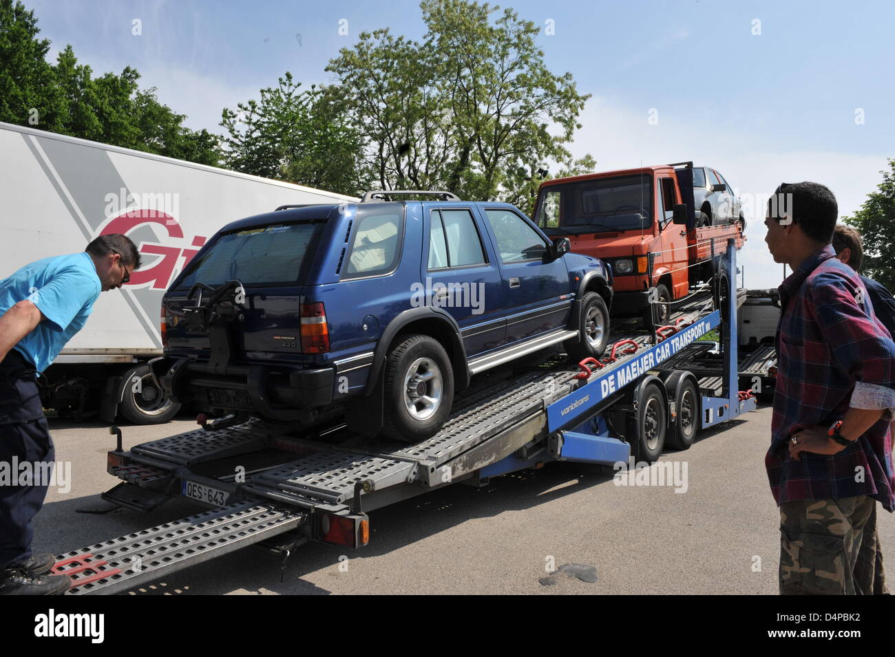 Used Cars Are Loaded On A Transporter For The Export To Africa In