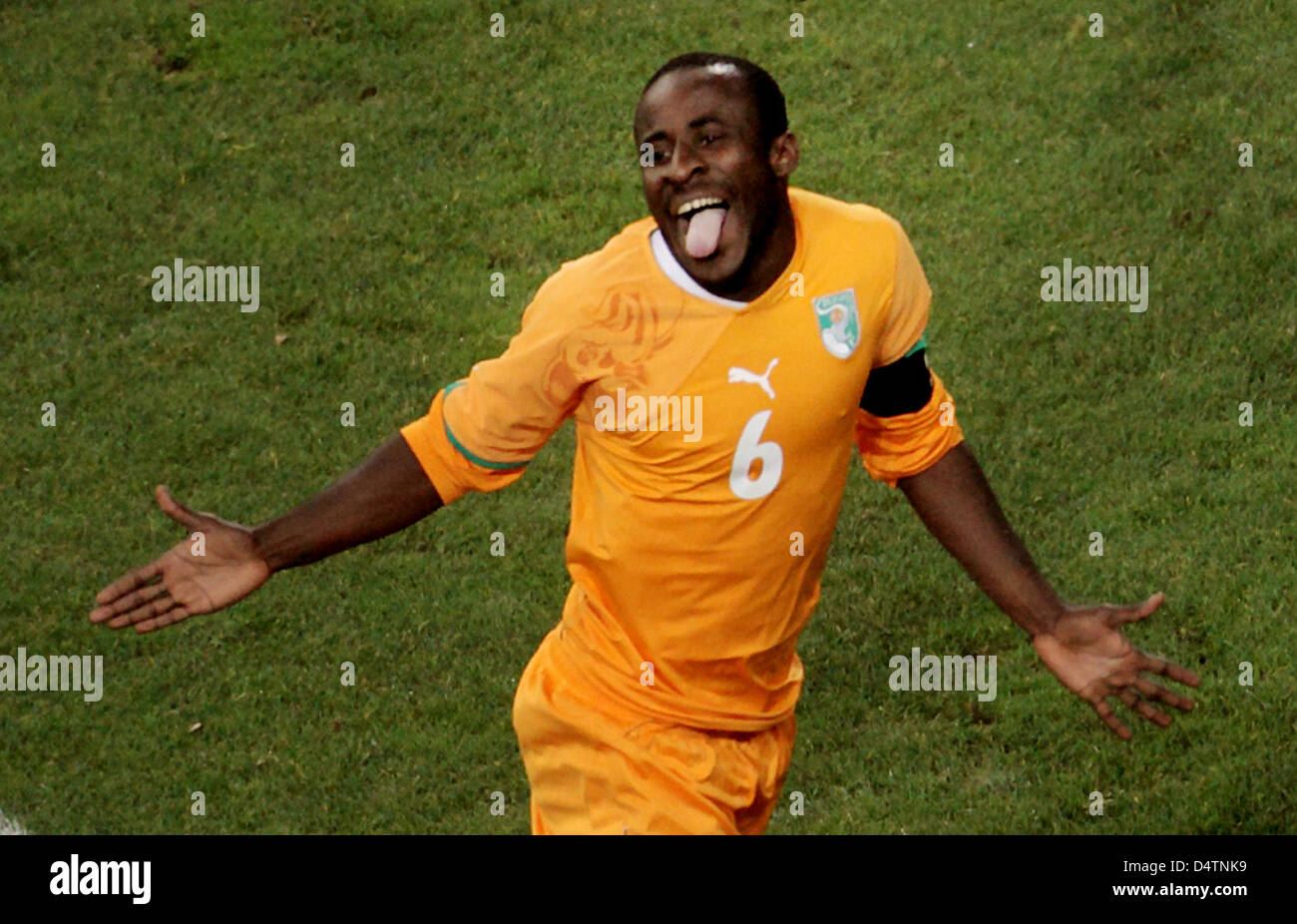 Ivory Coast s Seydou Doumbia cheers after scoring the goal