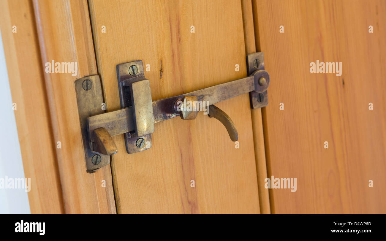 Brass door latch on a wooden door in a newly converted barn in ...