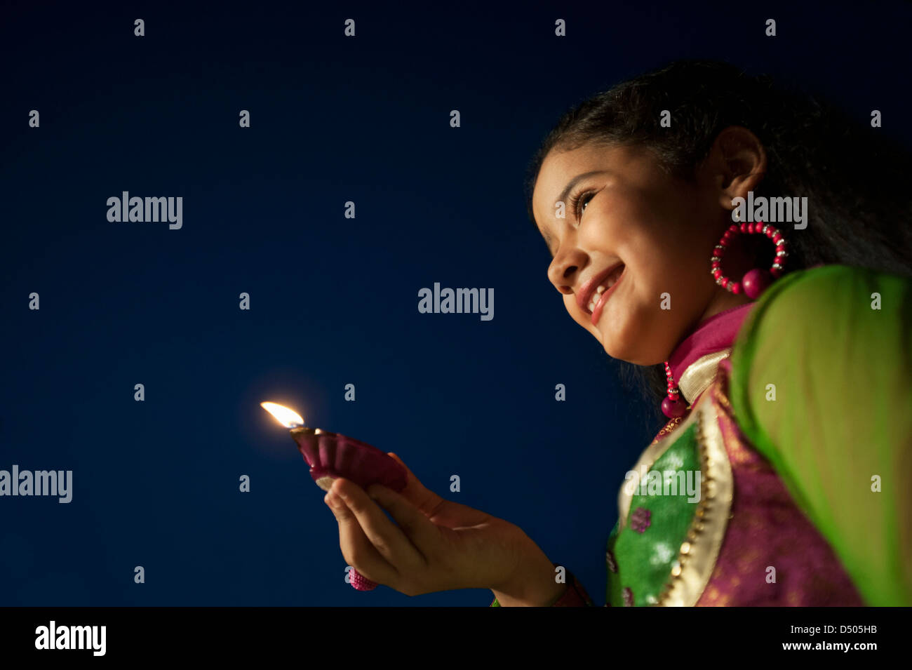 Girl holding an oil lamp on Diwali Stock Photo, Royalty Free Image ... for Girl Holding Lamp  173lyp