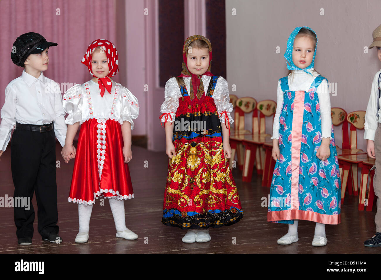 cute boys and girls in russian traditional clothes in kindergarten cute boys and girls in russian traditional clothes in kindergarten standing on theater stage russia