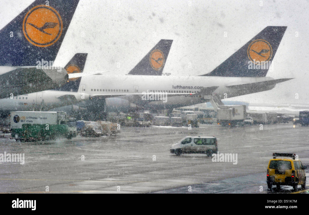 Planes Stand On The Airfield In The Snow At The Airport In