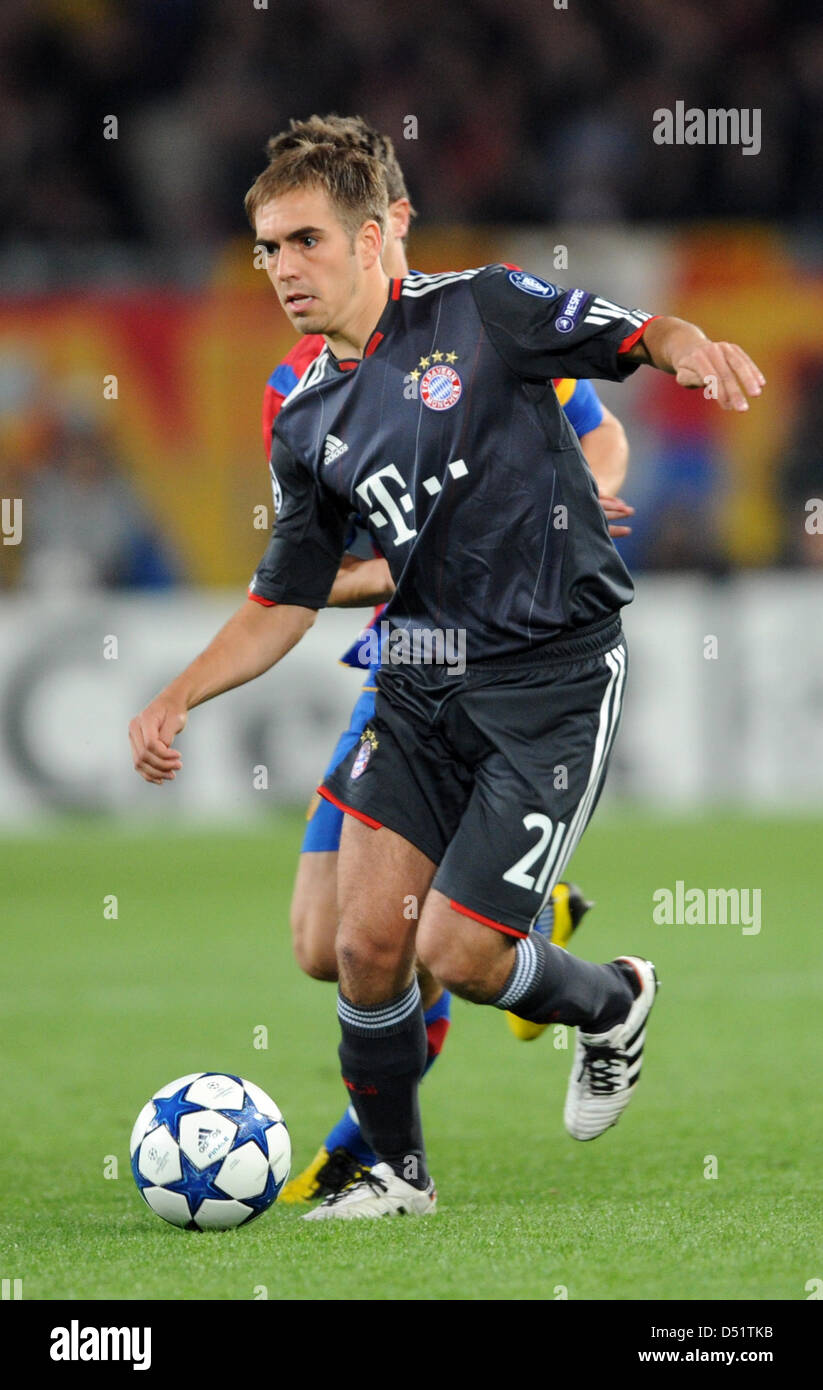 Munich s Philipp Lahm controls the ball during the Champions