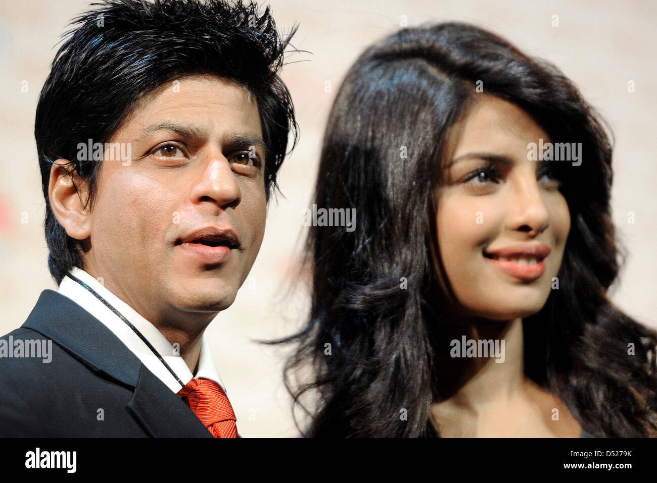 The Indian Actor Shahrukh Khan And Indian Actress Priyanka Chopra Stand On Stage During A Press Conference At The Event Venue Friedrichstadtpalast In Berlin