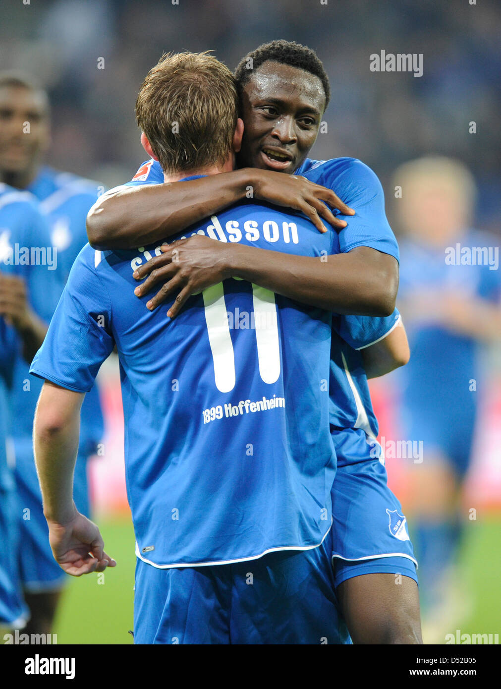 Hoffenheim s Gylfi Sigurdsson L and Chinedu Obasi cheer after