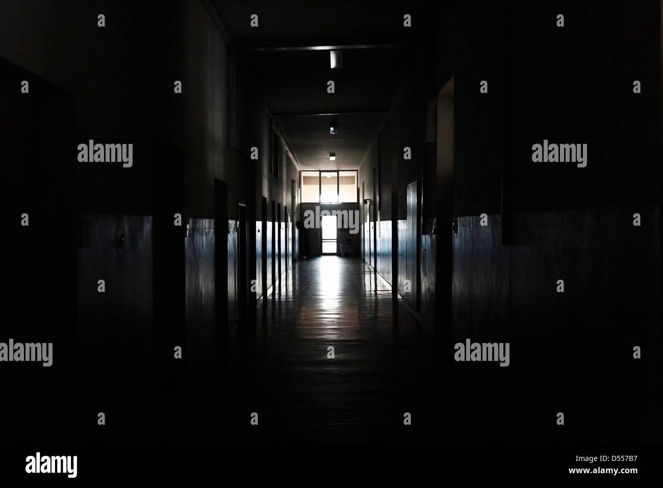 Light Shining From Door In Dark Hallway   Stock Image