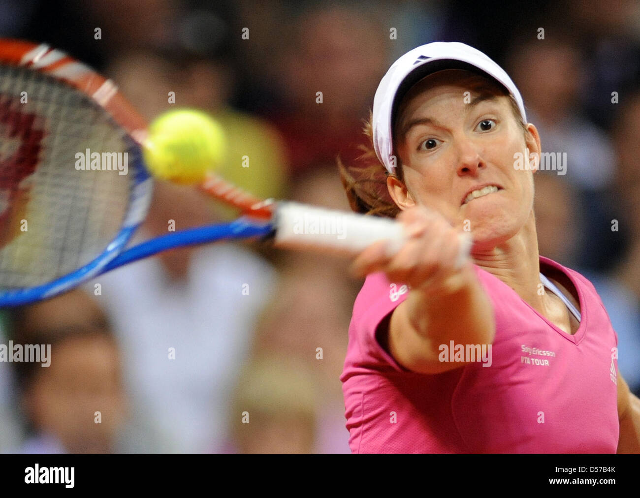 Belgium s Justine Henin plays against Australia s Samantha Stosur